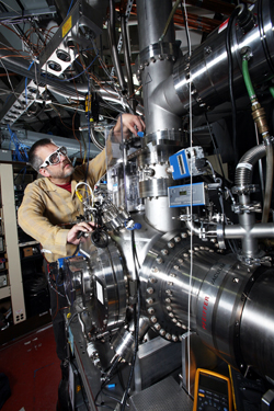 Combustion expert Craig Taatjes adjusts a multiplexed chemical kinetics reactor at the Advanced Light Source at Lawrence Berkeley National Laboratory. The unique machine probes individual chemical reactions with isomeric resolution. Experiments on this machine will help examine the fundamental autoignition chemistry of potential new biofuels.