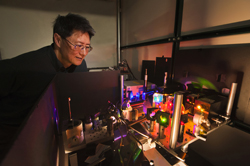 Sandia researcher Jeff Tsao examines the set-up used to test diode lasers as an alternative to LED lighting. Skeptics felt laser light would be too harsh to be acceptable. Research by Tsao and colleagues suggests the skeptics were wrong.