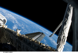 US Space Shuttle Atlantis and the Orbiter Boom Sensor System on-orbit during Mission STS-135.