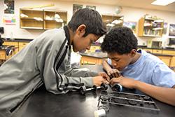 Two boys design their electric car.