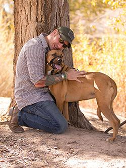 Rob Mitchell and his service dog, Hunni