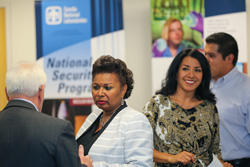 Sandia National Laboratories supplier diversity specialist Patricia Brown, right, and Theresa Carson, senior manager of Policy, Assurance and Outreach, greet business owners at a Sandia supplier open house. (Photo by Lonnie Anderson)