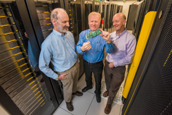 Roger Suppona, John Naegle, and David Follett hold Neuromorphic Cyber Microscope.