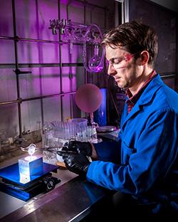 Sandia scientist Joey Carlson casting an organic glass scintillator.