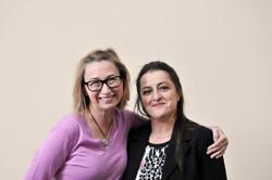 Angie Birnbaum and Nabila Seridi hugging.