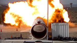Photograph of end view of blast tube in action.