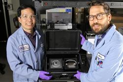 Photo of Sandia National Laboratories chemist Chung-Yan Koh and former Sandia bioengineer Chris Phaneuf
