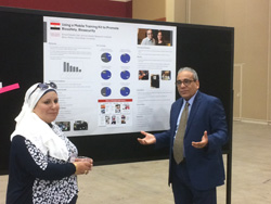 Emad Zaki pf Egypt explains his twinning project poster at the 2017 American Biological Safety Association conference.