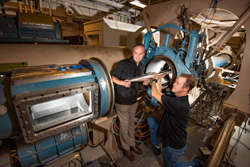 Steven Beresh and Russell Spillers place a model in the hypersonic wind tunnel