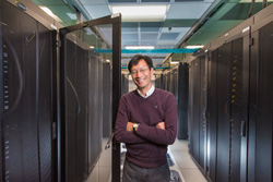 Vitus Leung between two stacks of supercomputers.