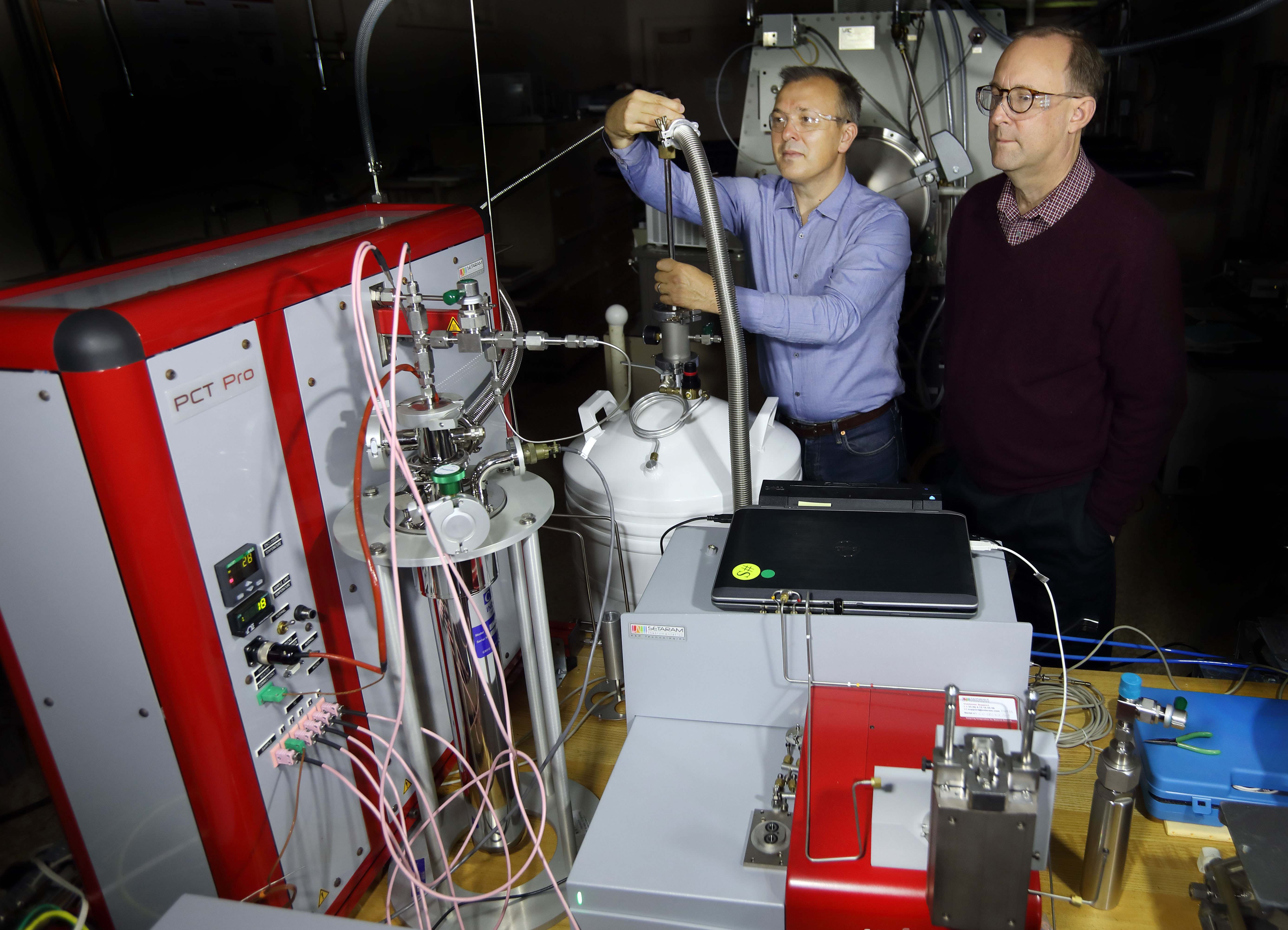 Sandia researchers Vitalie Stavila, left, and Mark Allendorf are part of a multilab consortium to advance storage materials for future hydrogen powered transportation.
