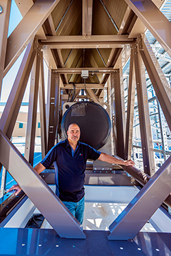 Dave Martinez stands near the thermosyphon cooler