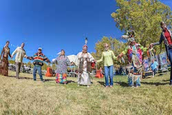 Photo of Sandia employees and Navajo Nation dance group Native American Heritage Month in November 2017.