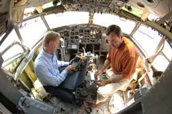 Mike Dinallo and Larry Schneider (left) prepare to employ the PASD diagnostic on a wiring bundle in the cockpit of a retired Boeing 737 at Sandia's FAA Airworthiness Assurance NDI Validation Center